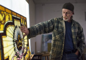 Bernie Evans shows his passion for the art as he explains the detail in this stained glass piece.