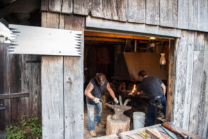 Rob Miller and Randy Baldwin working in the blacksmith shop.