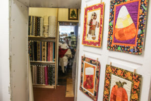 The shop boasts a multiple of rooms, all filled with shelves of material.