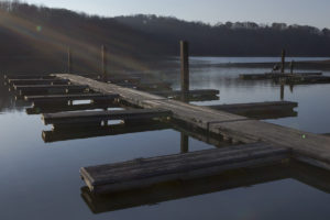 Sunlight rests on the docks at Salt Fork's lake.