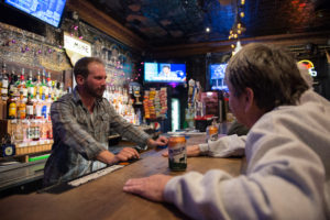 Bartender Ryan Wolfe talks to patrons at The Mine Tavern in Nelsonville on November 18th, 2016